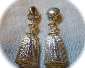 White metal 1960 light ribbon earrings