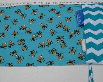 flip and go travel diaper changing pad/baby changing pad/travel diaper clutch with pockets - turquoise chevrons with playful monkeys