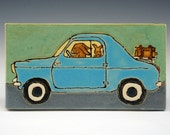 Rabbit family in an old blue car takes a holiday on a handmade ceramic tile