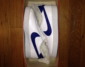 vintage nike burt bruin white / royal blue youth size 3