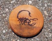 "RESERVED: Woodburned Serqet Scorpion (1.5"" Wood Round Oil-Dyed)"