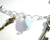 Silver charm bracelet with key charms and mint hearts with pink roses