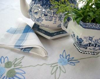 Blue and Green Embroidery on White Tablecloth