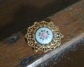 Round CORO brooch with Guilloche center