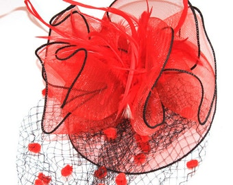 Red Fascinator with veil, accented with feather