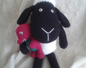 Sheep plushie cuddling his favourite toy/handmade