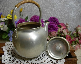 Aluminum Seep and Serve Tea Pot with Wicker Wrapped Handle.