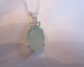 Interesting Faceted Oval Chalcedony Accented Pendant