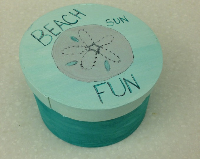 "4 1/2"" diameter round wood box with lid. Aqua with sand dollar and ""Beach, Fun, Sun"" on Top"