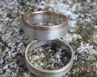 A Pair of Matte Silver and Gold Wedding Bands
