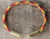 BRZN Bullet Casing Bracelet Fire Camo recycled .22lr shells red yellow orange camo paracord wire men women