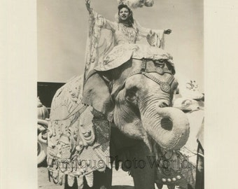 Circus performer elephant trainer posing vintage photo