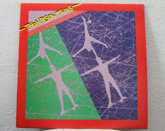 """Thompson Twins - """"In The Name Of Love"""" vinyl record (NT)"""