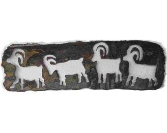 Bighorn sheep petroglyph panel in rustic sheet metal