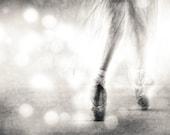 Andante--Ballerina's legs and feet shown en pointe in black/white