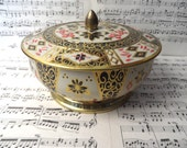 Crown Derby floral black, gold and orange round tin /  Made in England container, canister, cookie tin, lidded tin
