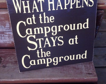 What happens at the campground stays at the campground, wooden sign