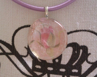 Purple cord necklace with glass pendant with a flower