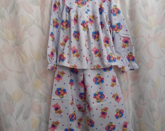 Size 12 girls pajamas with cats on blue and white check back ground