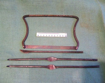 medieval surgeons instrument set 4 items saw scalpel and 2 wound retractors