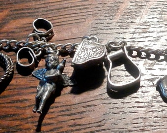 World War Two sterling charm bracelet with 12 charms
