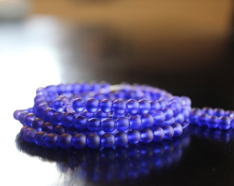 195 approx. 4 mm royal blue frosted glass beads, round and smooth, one strand for making jewelry