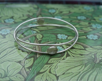 Double crossover bangle with two rock crystals