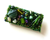 A green beaded brooch, a mixed media handmade fibre art jewellery in green.