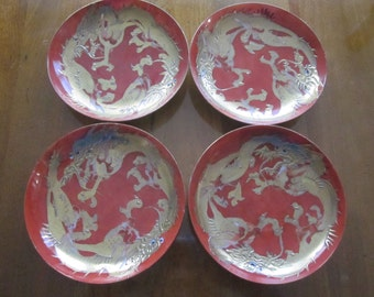 Four Fine Porcelain Plates, Striking Asian Dragon in Red and Gold, Signed on Reverse