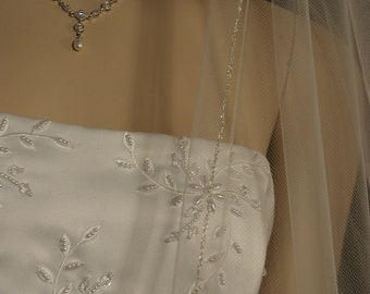 "Wedding veil. Silver pencil edging. 42"" fingertip length."