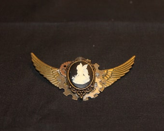 Fairy cameo mounted to small brass wings.
