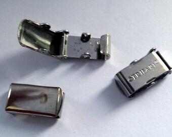 12 x Vintage marked TRIFARI fold over clasp closure - dark silver tone