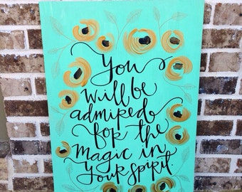 Teal, black, and gold painted quote, hand-lettered on wood