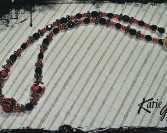 105 Black & Red Necklace with featured lampwork beads