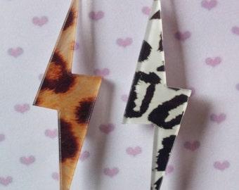 2 ray resin brooches, punk rocker