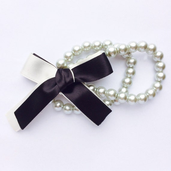 The Elsa Double Strand Pearl Bracelet accented Black and White Satin Ribbon