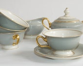 Windemere USA Grey and Gold Dishes 12 complete settings and more.