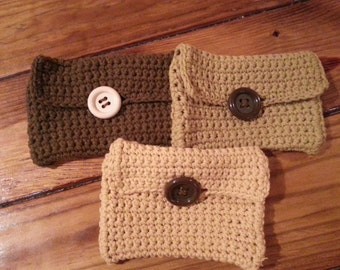 crocheted wallet or clutch. Button close. Can add a flower. Fits credit cards etc.