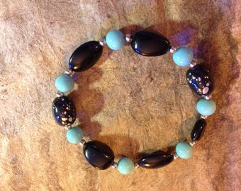 Vintage bead black and teal stretch bracelet with silver spacers