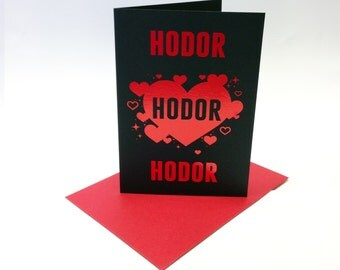 Game of Thrones inspired Valentine's card, 'Hodor' printed in red metallic foil with little love hearts. Size A6.