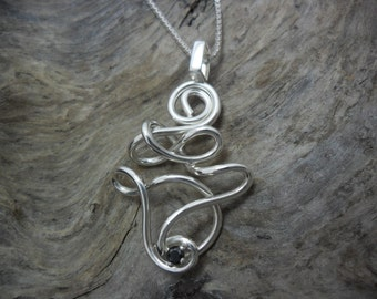 Sterling silver set with a black diamond pendant