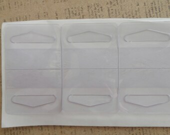 43 self adhesive slot style hang tabs for small and medium weight items