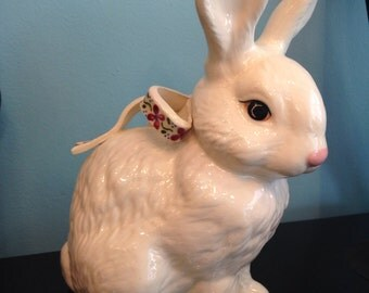 This Laraina Egglestons White Bunny rabbit with bow figurine is a rare find