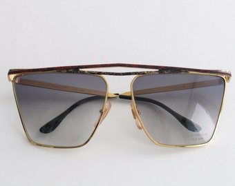 Laura Biagiotti beautiful vintage sunglasses for women. Made in Italy in the 80's.