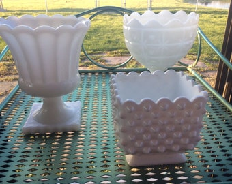 Milk glass set of three vases