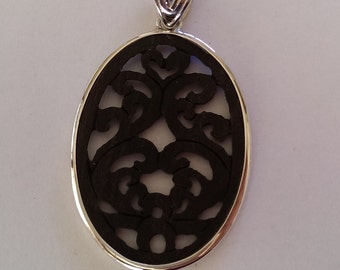 Handmade Sterling 925 silver and wood pendant.