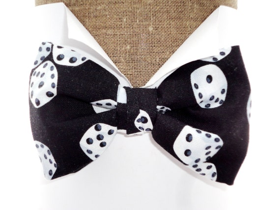 "Bow tie, white dice on black, pre tied on an adjustable neck band, will fit neck size up to 20"". Also available in self tie."