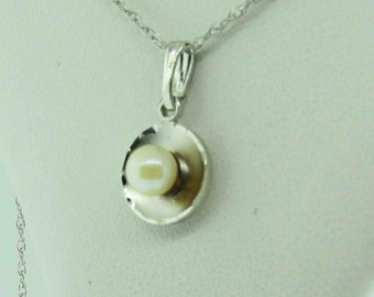 Sterling Silver necklace with white pearl.