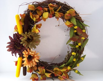 Outdoor indoor grapevine artificial autumn flower wreath with cattails.