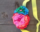 Daybreak// stacked jersey flowers in a prism of colors with bead centers on pistachio elastic headband